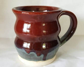 Handmade ceramic mug in red curvy pottery mug bold and unique