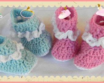 slippers size 3-6 months in pink or blue