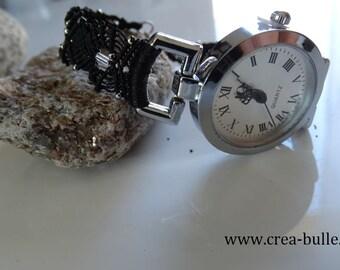 Watch jewel with woven in black macrame bracelet