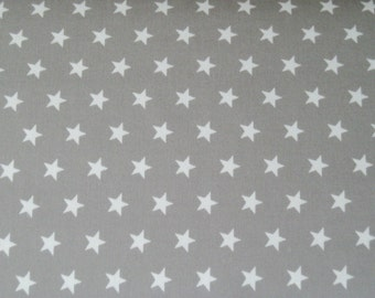 Taupe cotton fabric with white stars