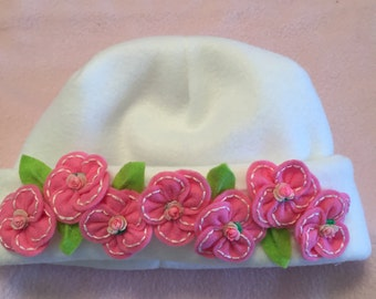 White Fleece Child's Hat with hand embroidered Pink Blossoms
