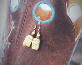 Earthy bronze and cream set of drop earrings.