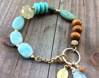 Lovely asymmetrical mint green beaded bracelet with charms