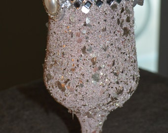 pink and silver shavings wine glass