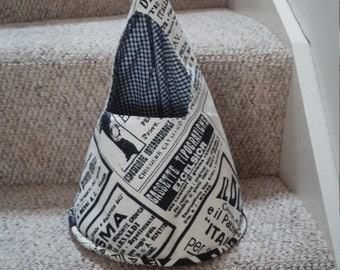 Peg bag. Conical shape. Newspaper fabric