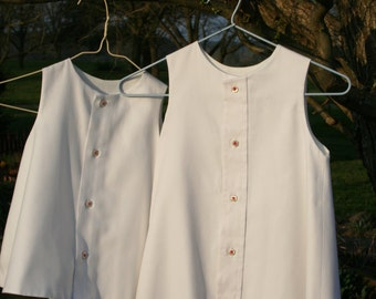 White Dresses/Jumpers with Pink Embroidered Buttons