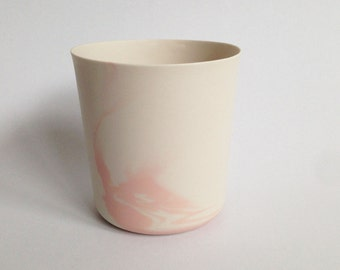 white-pink porcelain vessel