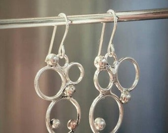 Sterling silver contemporary earrings.