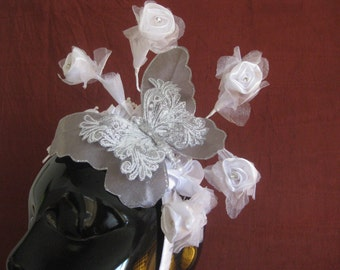 Silver butterfly and white flower fascinator