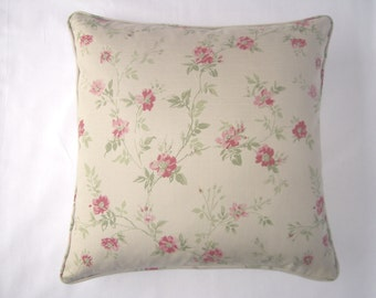Floral cushion cover in small roses design with trailing leaves.