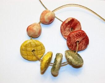 Set of 8 flashy textured colorfuls slices yellow green red matt handmade ceramic beads