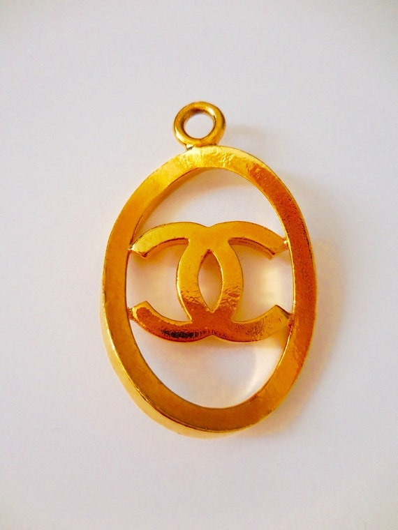 Authentic 38mm x 58mm vintage Chanel gold plated large size pendant with a CC logo