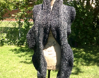 Grey crochet scarf.