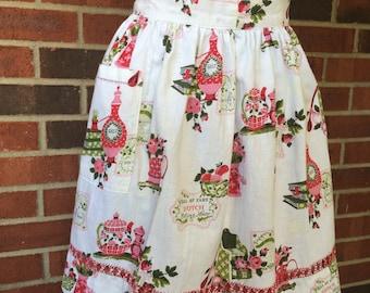 Vintage 1970s half apron, old fashioned kitchen motif
