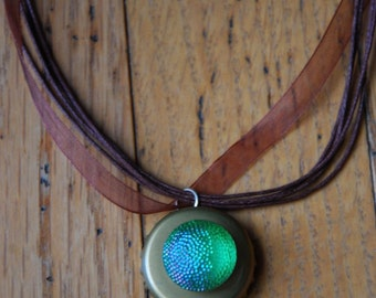 Brown and green reflecting bottle cap pendant ribbon necklace