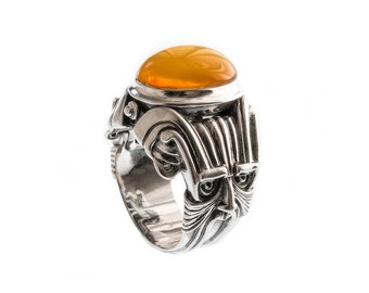 Sterling silver women's ring with natural amber.