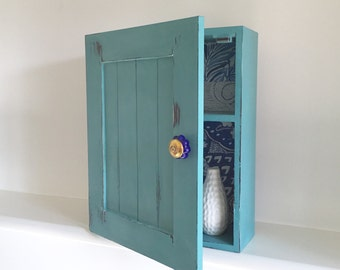 Green blue decorative hand painted wall cupboard.