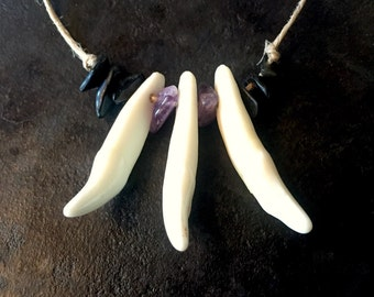 Wolf tooth necklace with amethyst and obsidian on a hemp cord