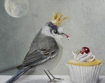 The grey bird with the cupcake