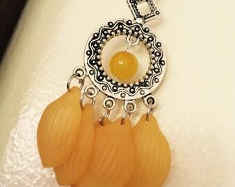 Yellow lucite petal light weight earrings.