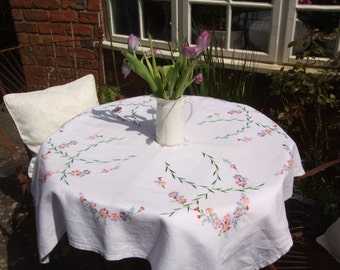 A gorgeous vintage hand embroidered table cloth from 1962