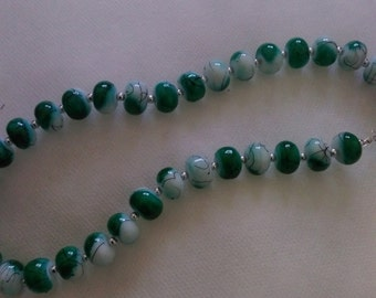 Green and white glazed necklace