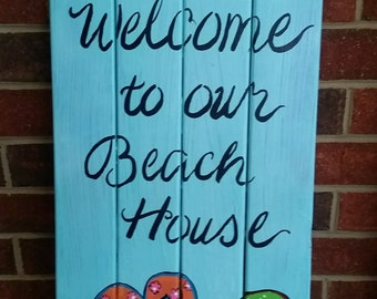 Welcome to our Beach House hand-painted wooden sign.
