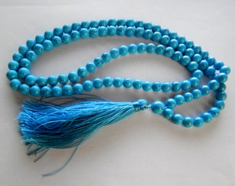 a rosary of beads compressed turquoise