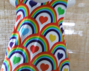 Rainbows and Candy Reversible Pinafore fits 6 months to 18 months/2 years.