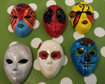 Masks painted to personal specifications.