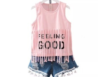 Pink fringe and denim shorts