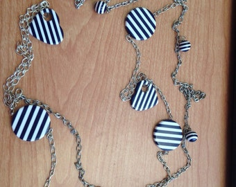 Navy Blue and white striped cirle and heart necklace.