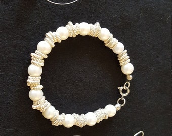 Pearl bracelet and earrings.  Can be sold individually