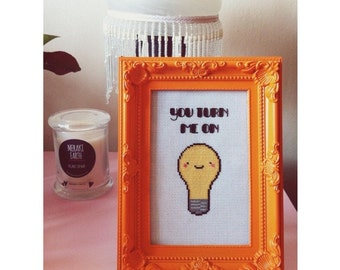 Light Bulb You Turn Me On Completed Cross Stitch in Orange Ornate Frame