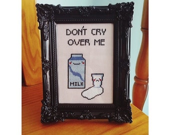 Don't cry over me! Spilt milk complete cross stitch in frame.