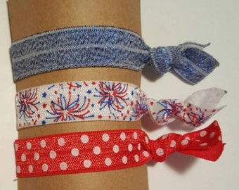 Red white and blue elastic hair ties