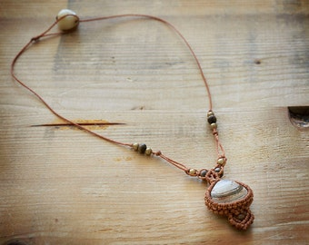 Brown macrame necklace with a shell