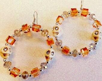 Bone color skull earrings
