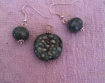 Matching pendant and earrings. Handmade unique jewellery made with my own lamp work glass beads