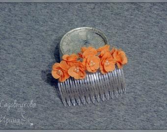 Comb with orange flowers