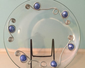 Glass plate embellished with milky blue stones