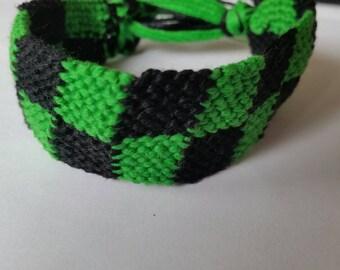 Green and black checkered friendship bracelet
