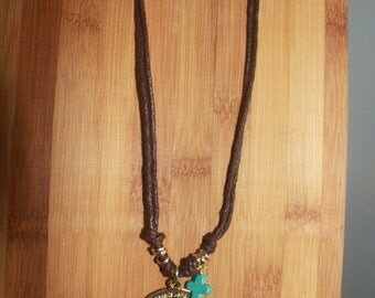 necklace of jute with cross and turquoise pendant