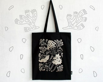 """Handmade and screen printed black cotton """"Forest spirit"""" tote bag with satin lining."""