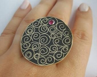 Scrolls ring.  Brass silver black resin. Pink zirconia