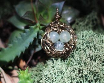 pale green eggs bird nest charm