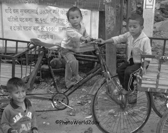 Faces of Nepal, Nepal, Nepal Children, Children playing, playing child, bicycle, bicycle child, kids, children playing, cycling child