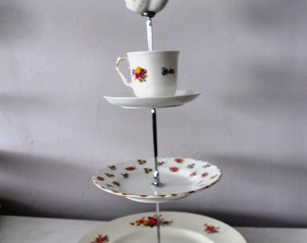 Vintage chintz bone china mad hatter cake stand with miniature tea pot feature