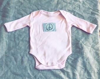 Baby bodysuit size 0000