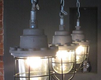 Submarine bulkhead pendant lights.